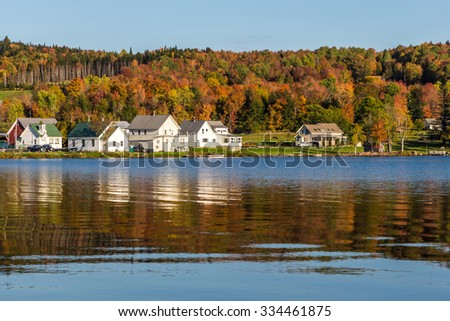 Autumn landscape and cabins on lake shore in Elmore state park. - stock photo