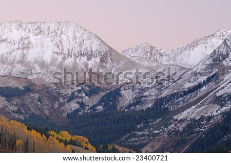 Autumn landscape at twilight San Juan Mountains with conifers and aspens, Colorado, USA - stock photo