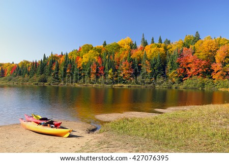 Autumn landscape. Autumn landscape with colorful forest. Colorful autumn landscape. Autumn colorful foliage over lake with beautiful woods in red and yellow color. Autumn forest reflected in water. - stock photo