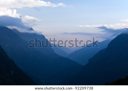 Autumn landscape in Himalaya Mountains, Nepal. Clouds and mountain valley. - stock photo