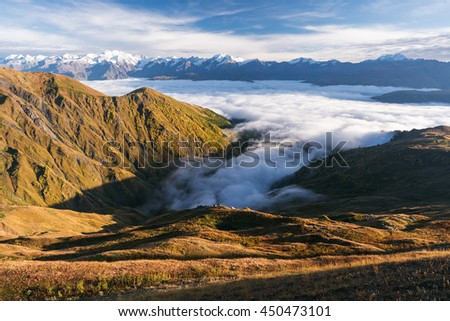 Autumn landscape in the mountains. Morning fog. Sunlight on the slopes. Tops in snow. Caucasus, Georgia, Zemo Svaneti - stock photo