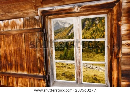 Autumn landscape in Wood window - stock photo