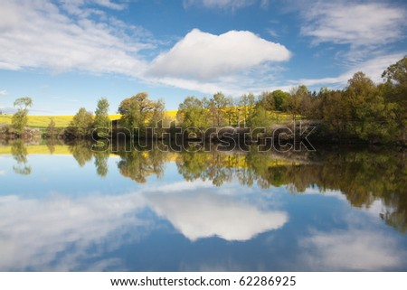 Autumn landscape of river and bright trees
