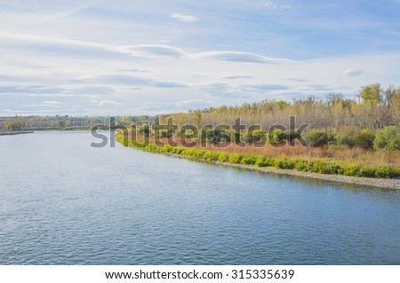 Autumn landscape of the Bow River in Fish Creek Park, Calgary. Alberta. - stock photo