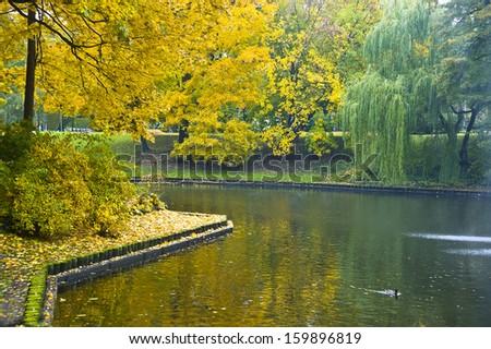 Autumn landscape on the city channel in Riga (Latvia). - stock photo
