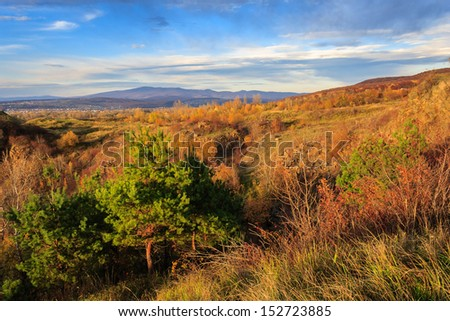 autumn landscape. the view from the high hill to the valley and the mountains far away. vertical - stock photo