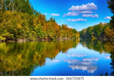 Autumn landscape, trees reflected in the water of the lake