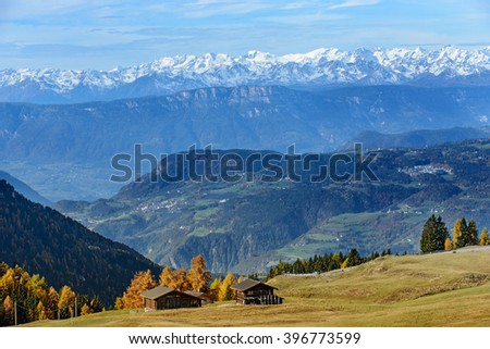Autumn landscape with bright colors, house and larch trees in the soft sunlight. Dolomiti, Italy - stock photo