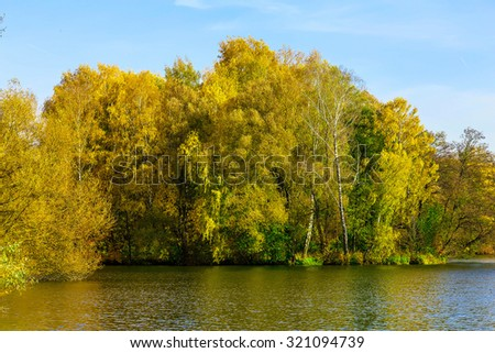 Autumn Landscape with Colourful Trees by the Lake at Sunny Day