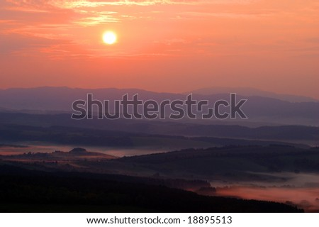 autumn landscape with fog - stock photo