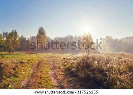 Autumn landscape with fog and a sunrise