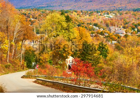 Autumn landscape with small town somewhere in New England - stock photo