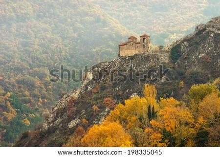 Autumn landscape with the church at Asen's Fortress near Asenovgrad, Bulgaria - stock photo