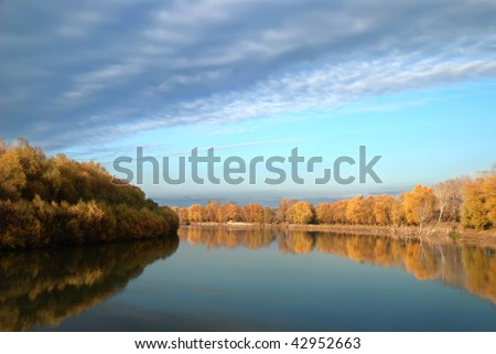 Autumn landscape with trees against the sky