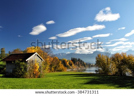 Autumn landscape with view on the Alps at the Forggensee in Allgäu, Bavaria, Germany.