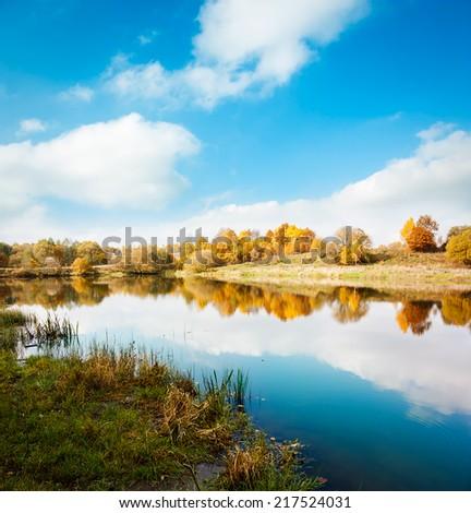 Autumn Landscape. Yellow Trees, Blue Sky and Lake. Fall Concept. Beautiful Season Background. - stock photo