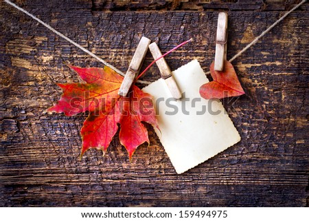 Autumn leaf and heart over wooden background/romantic Autumn  background with copy space - stock photo