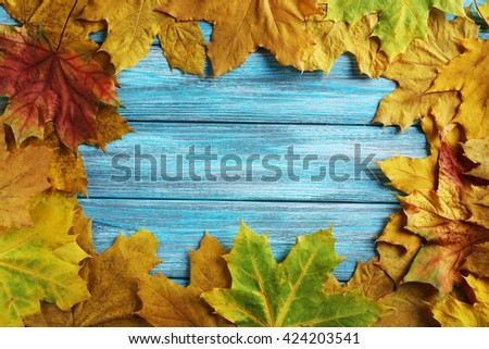 Autumn leafs on a blue wooden table - stock photo