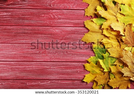 Autumn leafs on a red wooden table - stock photo