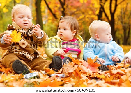 Autumn leaves and babies on them - stock photo