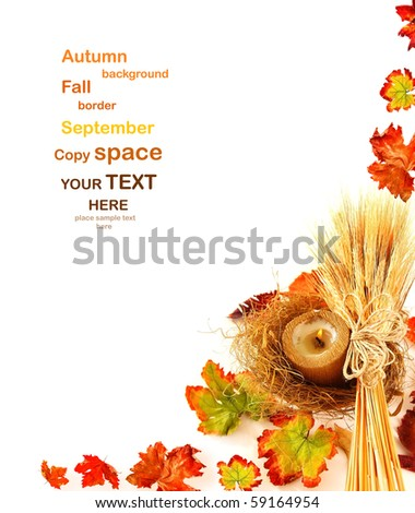 Autumn leaves border with candle & wheat isolated on white - stock photo