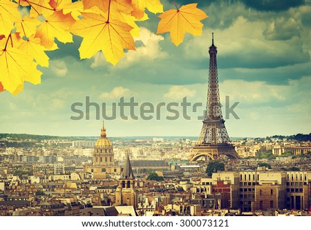 autumn leaves in Paris and Eiffel tower - stock photo
