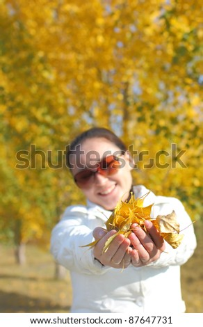 autumn leaves in the hands women - stock photo