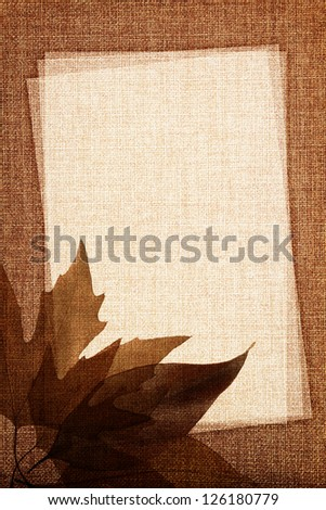 Autumn leaves on fabric texture with copy space - stock photo