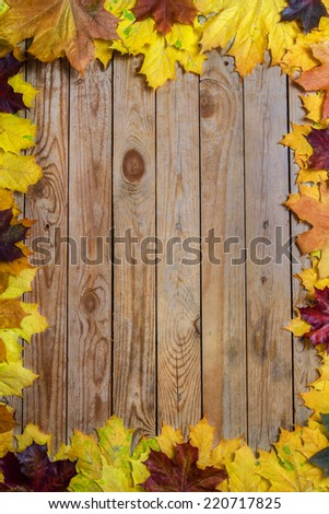 Autumn leaves on the wood - stock photo