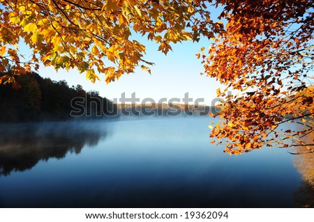 Autumn Leaves Over the Lake - stock photo