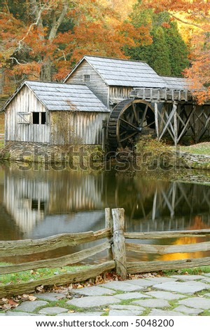 Autumn Mabry Mill Virginia Reflected in Pond Vertical - stock photo