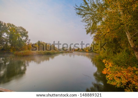 Autumn misty day on a River. Beautiful place. - stock photo
