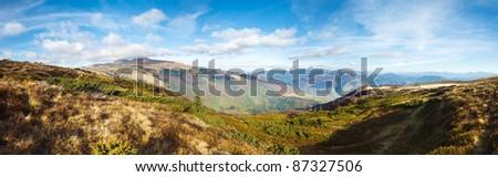 Autumn misty mountain panorama (Carpathian Mt's, Ukraine). Three shots stitch image. - stock photo