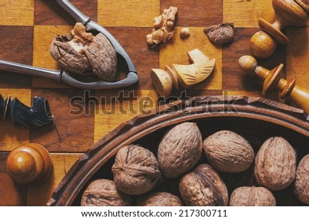 Autumn mood. Chess and walnuts. Food and games concept. - stock photo