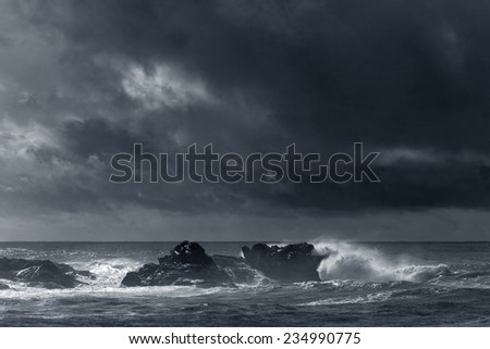 Autumn moody seascape with interesting light. Toned black and white. - stock photo