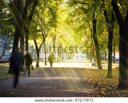 Autumn morning city alley and people hurrying to work - stock photo