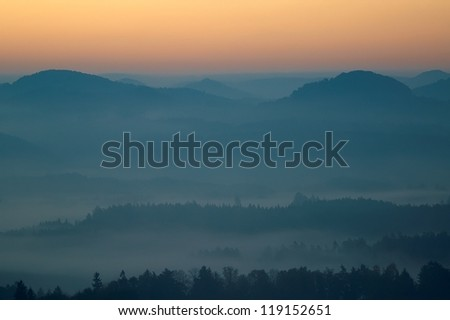 autumn morning hilly landscape with fog