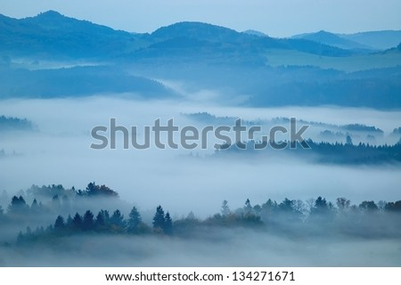 autumn morning hilly landscape with fog - stock photo
