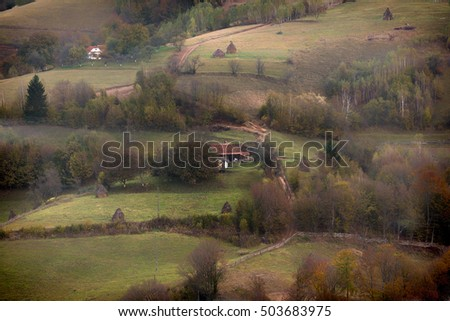Autumn morning on mountain hills landscape. Different kind of light. Low key, dark background, spot lighting, and rich Old Masters
