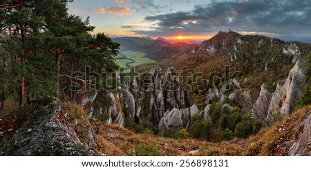 Autumn mountain at sunset with rocks - stock photo