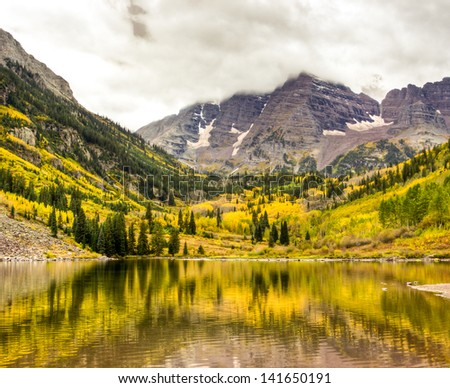 Autumn mountain lake landscape on a cloudy day. Colorado, USA - stock photo