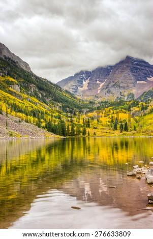 Autumn mountain lake landscape on a cloudy day. Colorado, USA - stock photo
