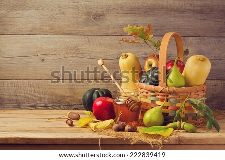 Autumn nature concept. Fall fruits and pumpkin on wooden table. Thanksgiving dinner - stock photo