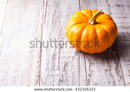 Autumn old wood background with pumpkin with copy space.