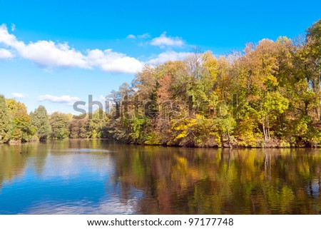 autumn on lake in park - stock photo