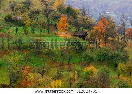 Autumn on the slopes of the mountain village. Beauty in nature - stock photo