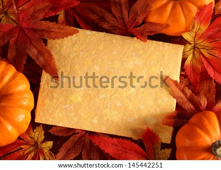 Autumn or thanksgiving greeting card with copy space. (artificial leaves)  - stock photo