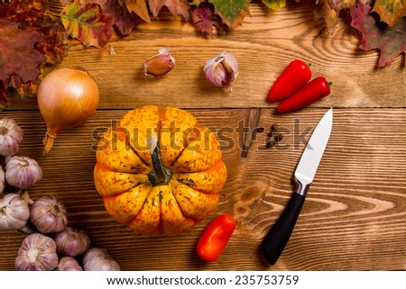 Autumn orange and yellow pumpkins on wooden table
