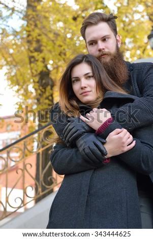 Autumn outdoor portrait of young heterosexual couple.  - stock photo