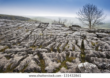Autumn over limestone pavement at Malham in Yorkshire Dales National Park - stock photo